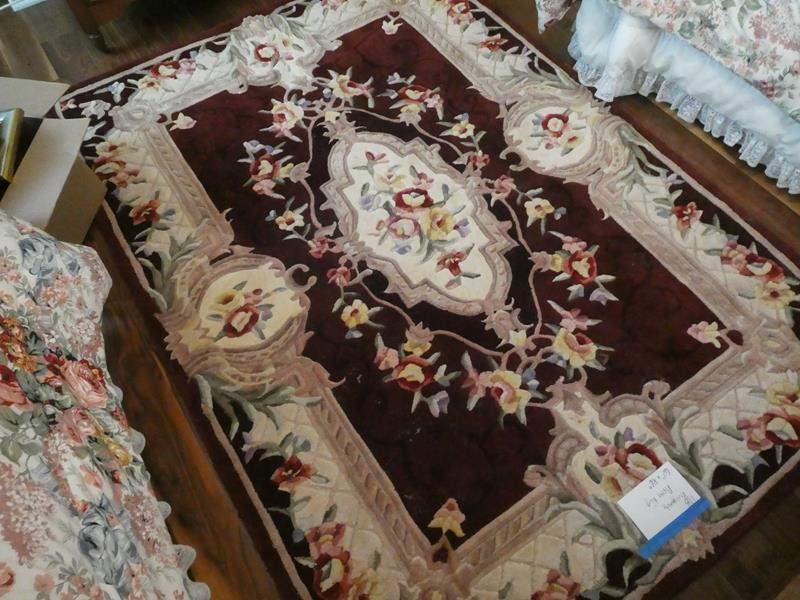Lot # 118- Burgundy floral area rug (main image)