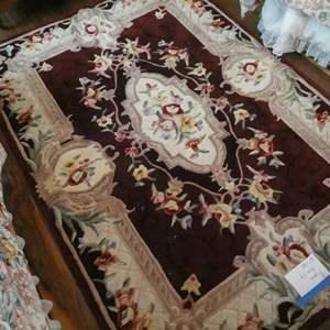 Lot # 118- Burgundy floral area rug