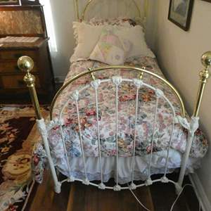 Lot # 120- Twin bed, brass and iron with bedding, mattress, and pillow