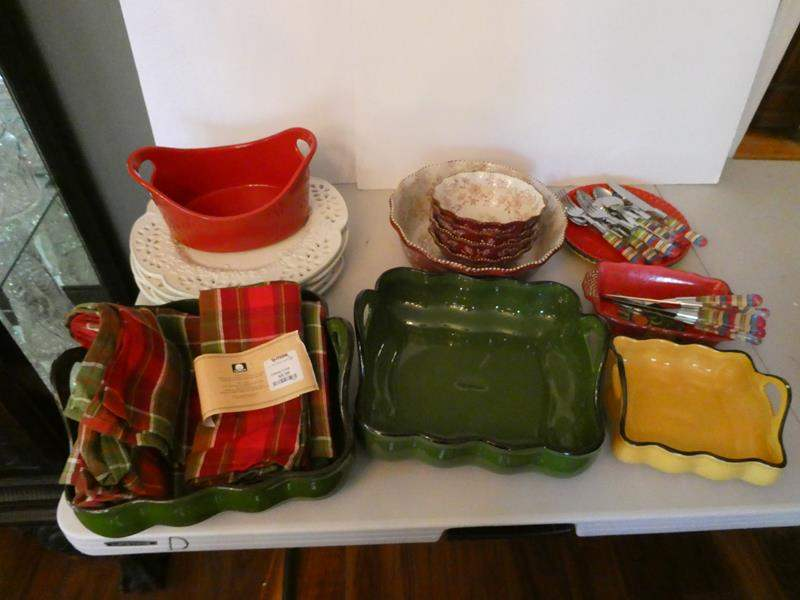 Lot # 21- Very stylish and colorful Dishes, Platter with salsa bowls, flatware, serving platters, and place settings. (main image)