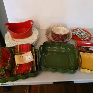 Lot # 21- Very stylish and colorful Dishes, Platter with salsa bowls, flatware, serving platters, and place settings.