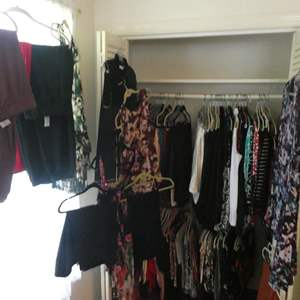 Lot # 121- WOW! Entire closet full of women clothes on hangers. Some new. Sizes M-XL