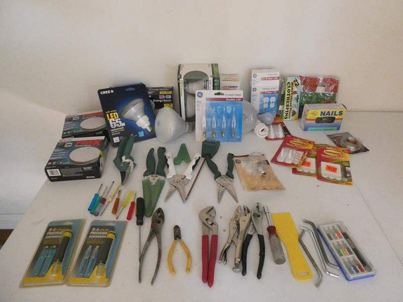 Lot # 124- Gardening tools and light bulbs (main image)