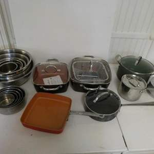 Lot # 27- Quality cooking ware. Some never used. Metal mixing bowls