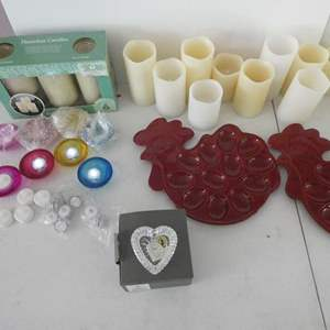 Lot # 130- Variety of candles, egg trays, and crystal heart ring holder