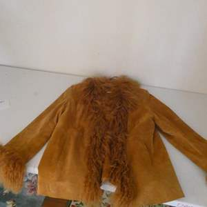 Lot # 133- Leather women's jacket, size XL with fur collar and at wrists