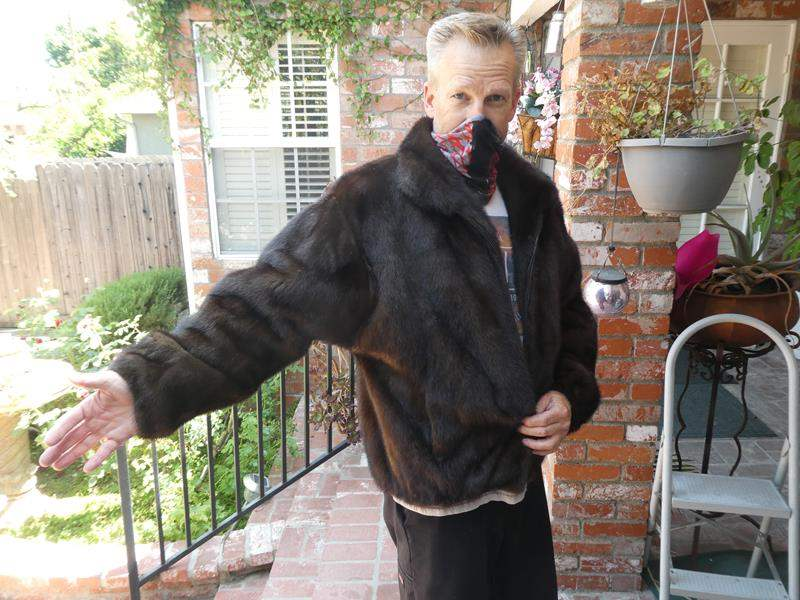 Lot # 134- Women's fur or faux fur? Size XL (handsome man not included) (main image)