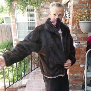 Lot # 134- Women's fur or faux fur? Size XL (handsome man not included)
