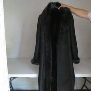 Lot # 136- Women's leather/ lamb Jacket, Tahari, size L