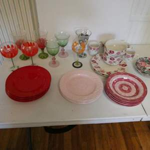 Lot # 30-Hand painted wine glasses. Several pattern dishes. Pink, red, and floral prints. Whole cupboard of wine glasses
