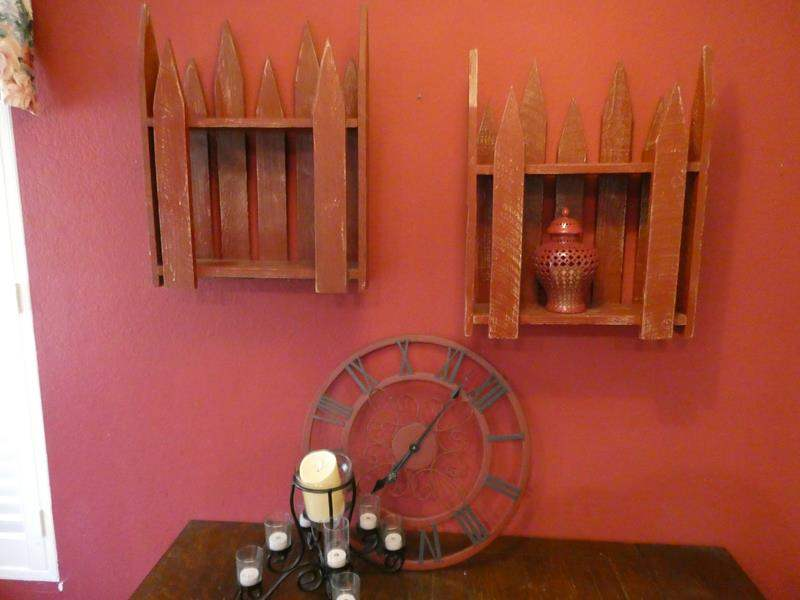 Lot # 37- Cute rustic home decor- Red fence shelves, black and red wall clock, candles, and vase (main image)