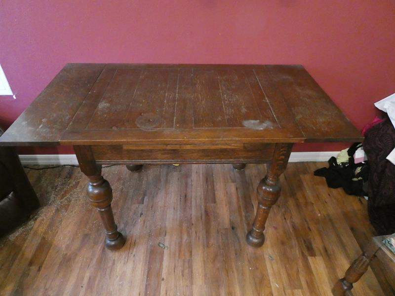 Lot # 38- Rustic style table with 4 flowered print chairs (main image)