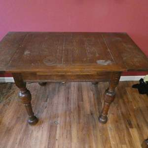 Lot # 38- Rustic style table with 4 flowered print chairs
