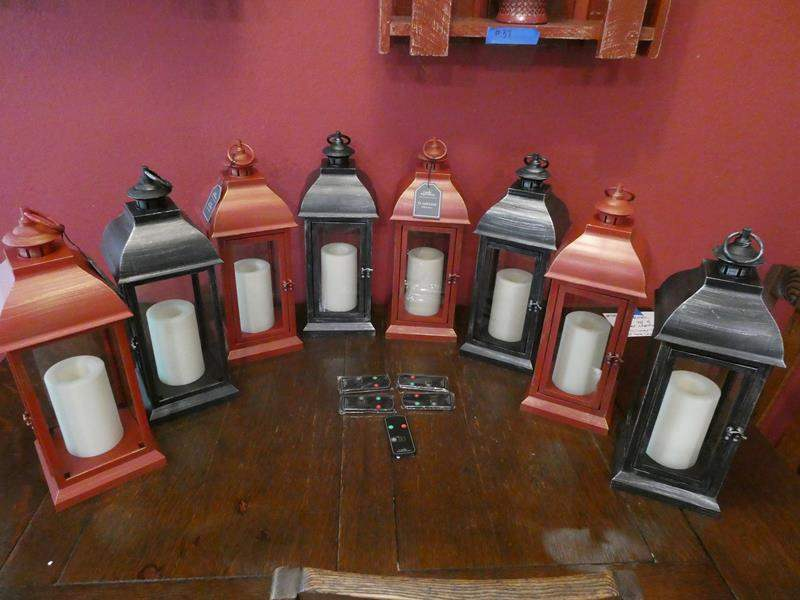 Lot # 40- Never used black and red lanterns with remotes (main image)