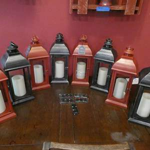 Lot # 40- Never used black and red lanterns with remotes