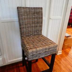 Lot # 46- Tall wicker chair (bar-stool size)