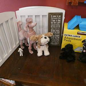 Lot # 42- I love dogs! Cute sign, puppy pads, nice wood puppy gate, and more