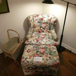 Lot # 149-Floral wing back, arm chair with ottoman, Lamp and basket