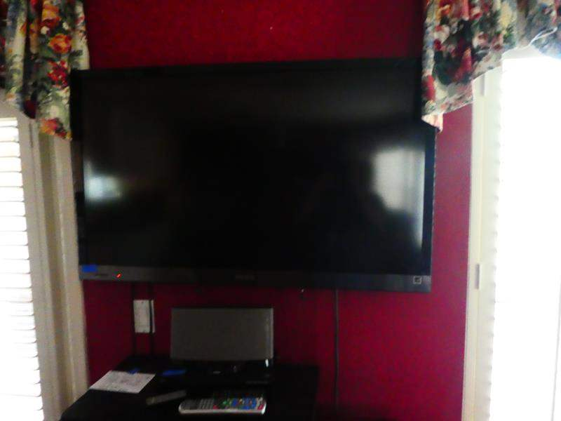 """Lot # 47- 48"""" Sony smart TV, Bose speaker (3g), Sony DVD player with remotes, and black turn table (main image)"""