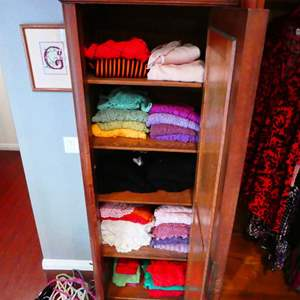 Lot # 213-Knit cardigans and sweaters, whole cupboard full in every color.