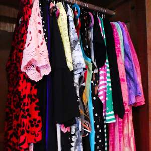 Lot # 214-Dresses, most size large, some with tags. Take a look.