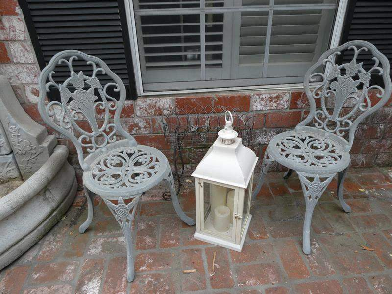 Lot # 301- Outside decor: 8 planters with succulents, metal planter, white, metal chairs, lanterns, statue and shepherd hooks (main image)