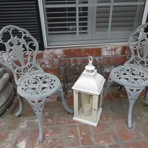 Lot # 301- Outside decor: 8 planters with succulents, metal planter, white, metal chairs, lanterns, statue and shepherd hooks