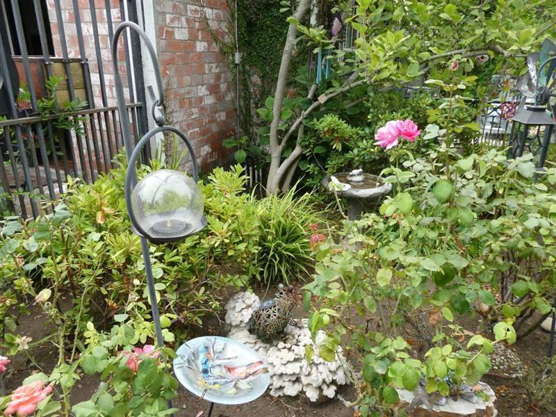Lot # 302-Amazing outside yard art. Bird bath, shepherd hooks, yard art and lots of wind chimes (main image)