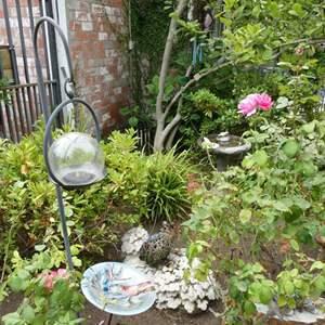 Lot # 302-Amazing outside yard art. Bird bath, shepherd hooks, yard art and lots of wind chimes