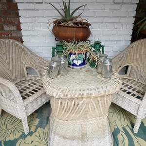 Lot # 307-Wicker yard furniture (used and needs pads,but nothing broken)   Standing plant/pot and other yard items.
