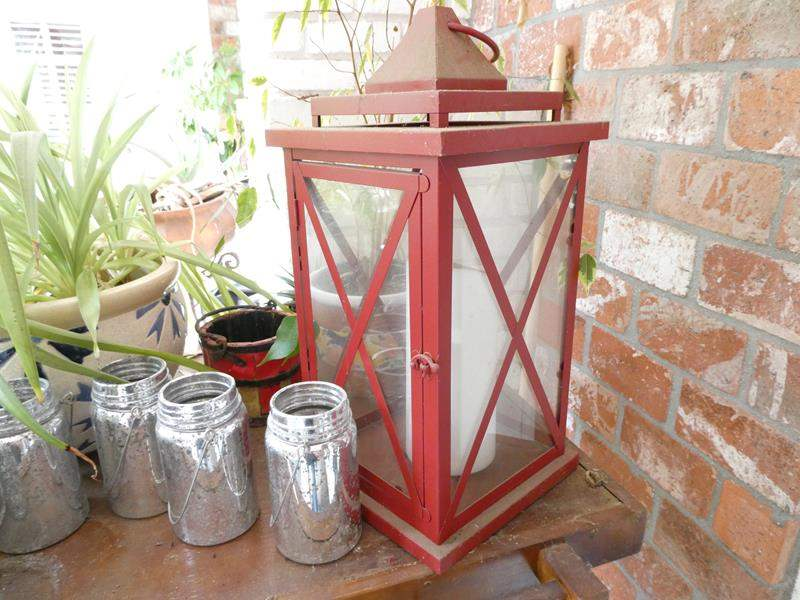 Lot # 308-Wood Stand with several planted pots, lantern, bird house and more. (main image)