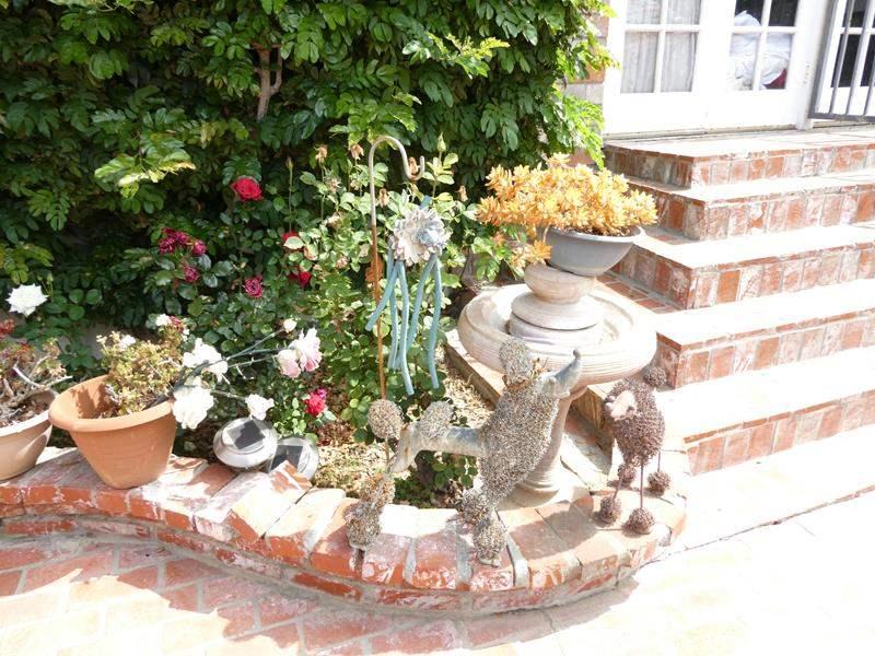 Lot # 312-Bird bath fountain, cement pots, metal dog figurines. (main image)