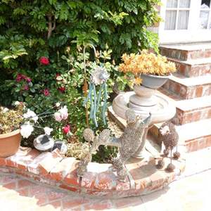 Lot # 312-Bird bath fountain, cement pots, metal dog figurines.