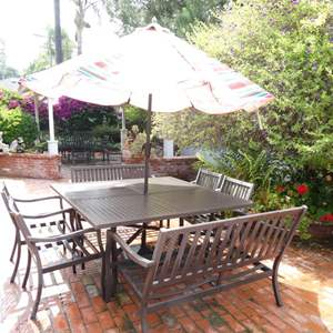 """Lot # 313-Aluminum patio furniture 65' X 64"""", 4 chairs 2 bench (great condition), with umbrella."""