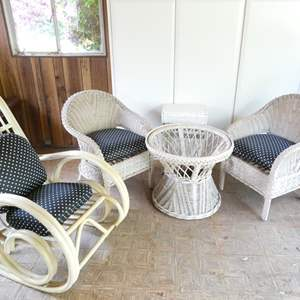 Lot # 321-White wicker furniture with table hamper & rocking chair. used, but hood condition. (table missing glass top)