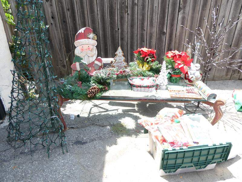 Lot # 324-So Ho Ho much CHRISTMAS, several wreaths, decorations, wrapping paper,5-6 storage bins with surprises inside. (main image)