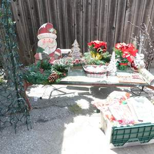 Lot # 324-So Ho Ho much CHRISTMAS, several wreaths, decorations, wrapping paper,5-6 storage bins with surprises inside.