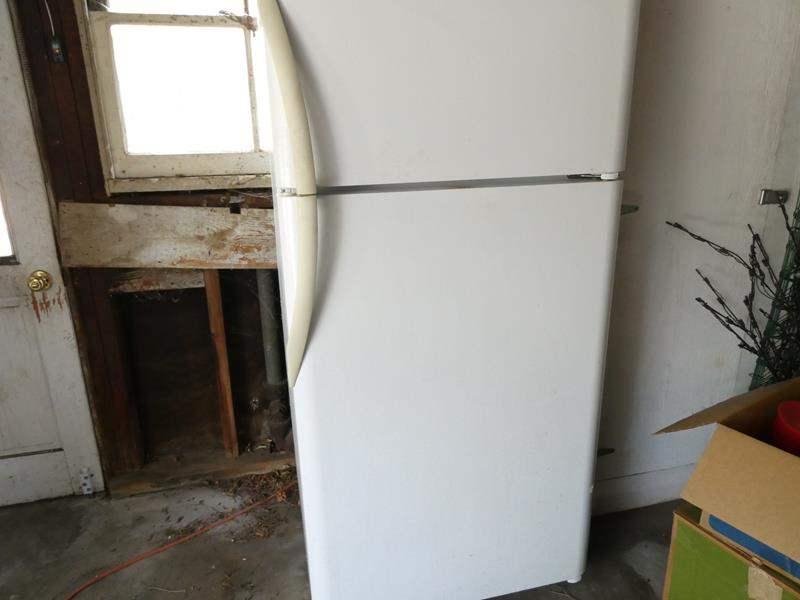 "Lot # 325-Fridge/freezer working, but needs cleaning 31""deep, 66""tall, 29"" wide (main image)"