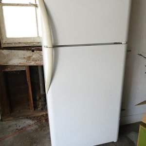 "Lot # 325-Fridge/freezer working, but needs cleaning 31""deep, 66""tall, 29"" wide"