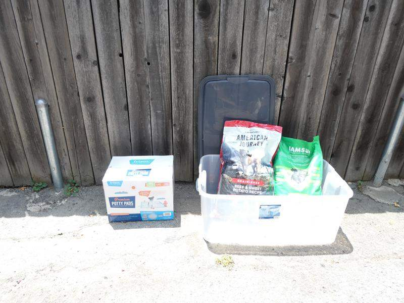 Lot # 331-Puppy love, puppy pads and dog food (main image)