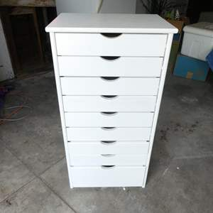"""Lot # 336-Brand new tall dresser, small drawers, great condition 39""""tall, 19""""wide, 14"""" deep."""