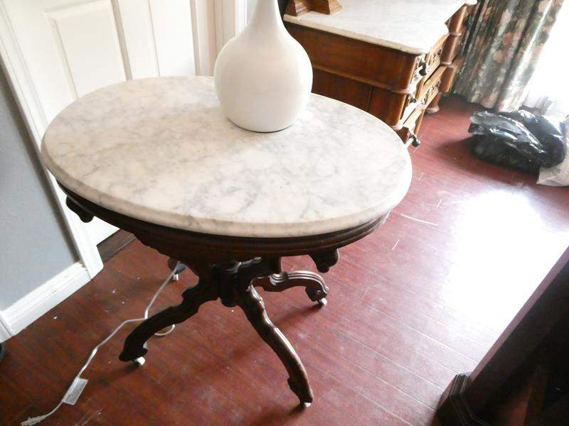 Lot # 220-Antique night stand/side table with lamp, marble top, sturdy, on wheels, some apparent repairs have been mad on legs. (main image)