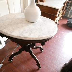 Lot # 220-Antique night stand/side table with lamp, marble top, sturdy, on wheels, some apparent repairs have been mad on legs.