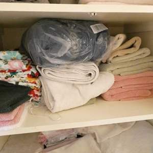 Lot # 229-Oh Sheet! Entire closet of blankets, towels, sheets, some nice, some new, some used.