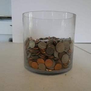 "Lot # 35- Heavy glass jar full of change! Diameter approx. 6"""
