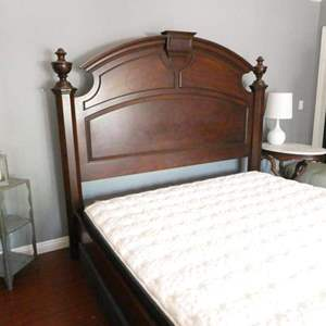 Lot # 217-king size Bed 6' X 8', sturdy, solid dark wood