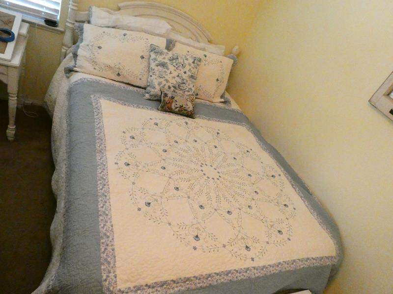 Lot # 149-Queen bed, head board, bed frame, mattress, box spring and bedding included (main image)
