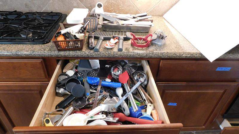 Lot # 49-Drawer full of kitchen treasures (utensils) and a tray of knives (main image)