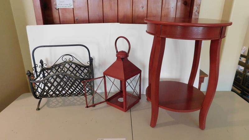 Lot # 59-Red wood end table with matching Metal Lantern and a sturdy metal magazine rack. (main image)
