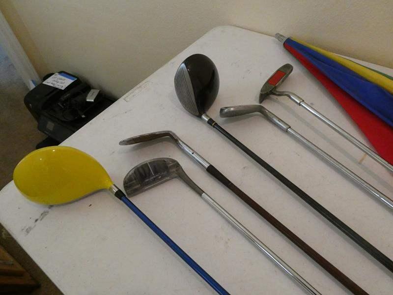Lot # 168-Golf clubs, golf gloves (4), golf umbrella and golf clubs (main image)